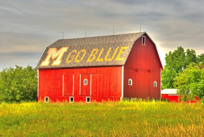 """A barn with """"M Go Blue"""" on the roof. - WICHAI CHEVA PHOTOGRAPHY / SHUTTERSTOCK.COM"""