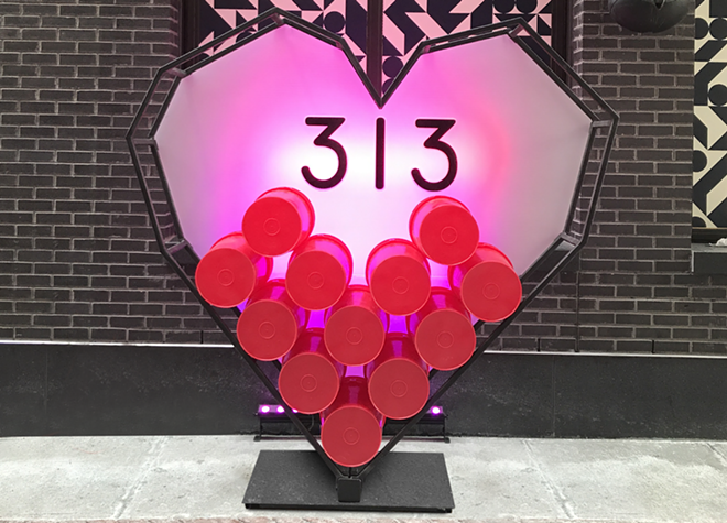 """Melinda Anderson of Studio M Detroit partnered with Bedrock Detroit and Prop Art Studio to place a 313 Day installation in Parker's Alley. The heart-shaped structure with """"313"""" in the middle is the perfect spot to take 313 Day selfies. - PHOTO BY MELINDA ANDERSON @STUDIOMDETROIT"""