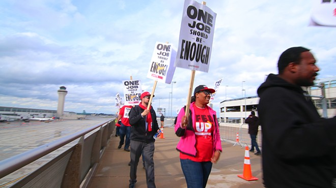 Shandolyn Lewis, center, and other union workers protesting at the Detroit Metropolitan-Wayne County Airport Terminal. - UNITE HERE