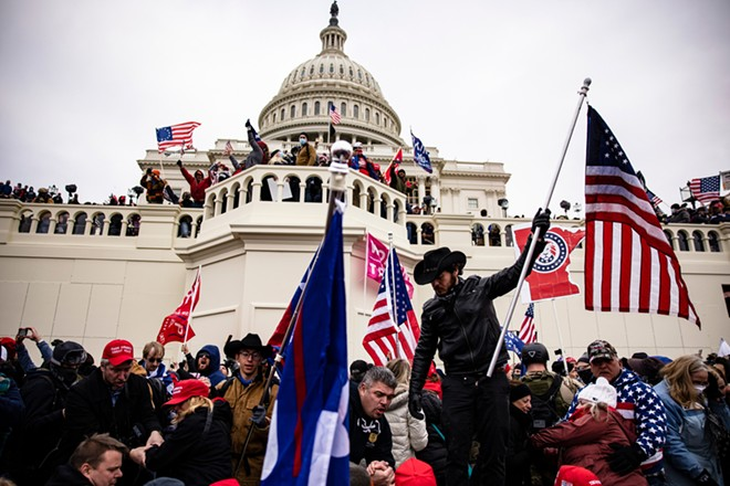 Pro-Trump supporters storm the U.S. Capitol following a rally with President Donald Trump on January 6, 2021 in Washington, D.C. - ALEX GAKOS / SHUTTERSTOCK.COM