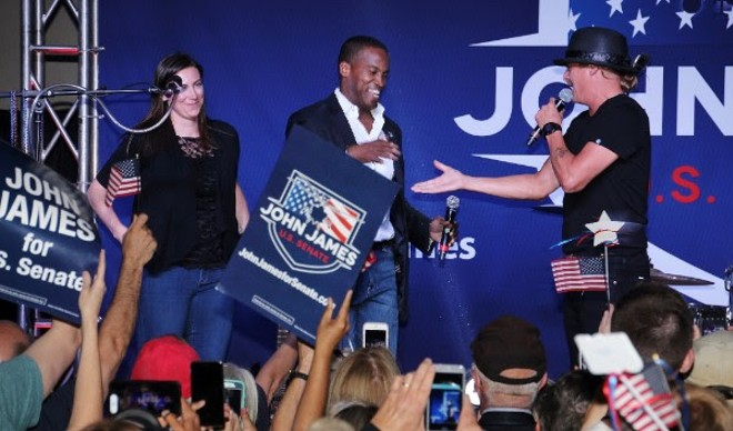 John James, center, who ran for U.S. Senate, was endorsed by Kid Rock,  right, who didn't run for Senate but pretended to. - COURTESY PHOTO