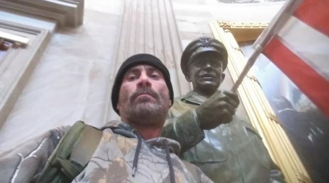 Anthony Robert Williams poses next to statue in U.S. Capitol. - FBI