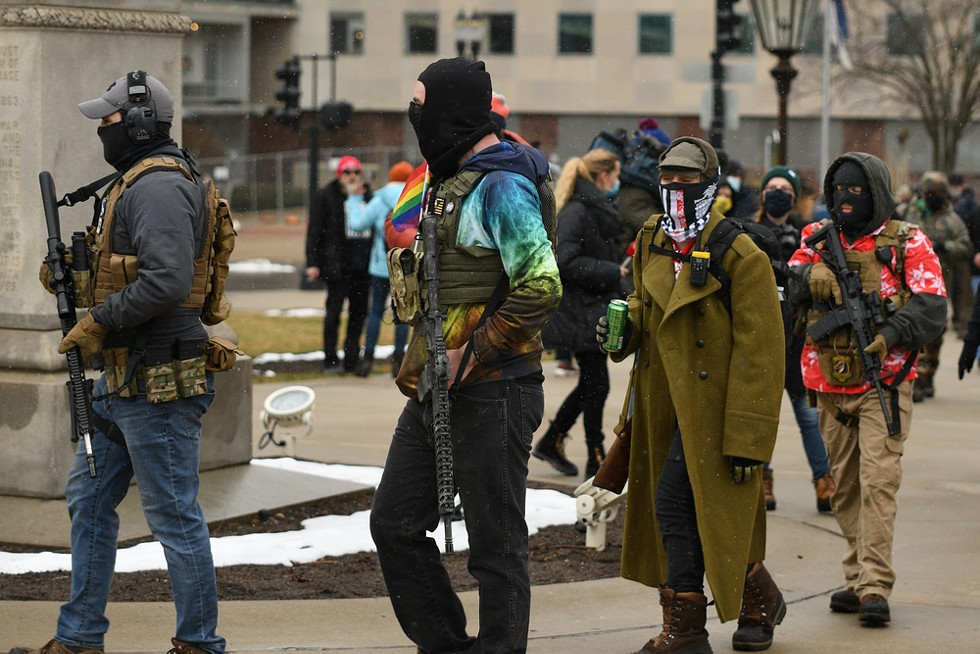 Armed protestors in Lansing support Donald Trump's baseless claims of election fraud. - LESTER GRAHAM / SHUTTERSTOCK.COM