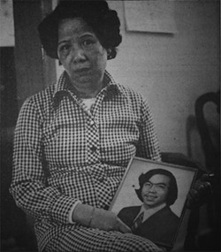 Lily Chin holds a picture of her son, Vincent. - HELEN ZIA