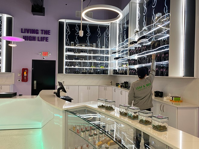 A growing industry: Leaf and Bud's neon-accented sales floor. The new dispensary claims to be Detroit's largest. - COURTESY PHOTO