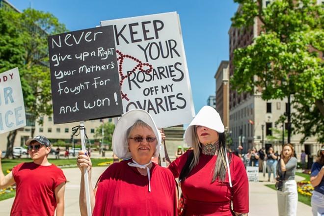 A Handmaid's Tale-themed pro-choice rally in Lansing. - RACHEL GOODHEW / SHUTTERSTOCK.COM