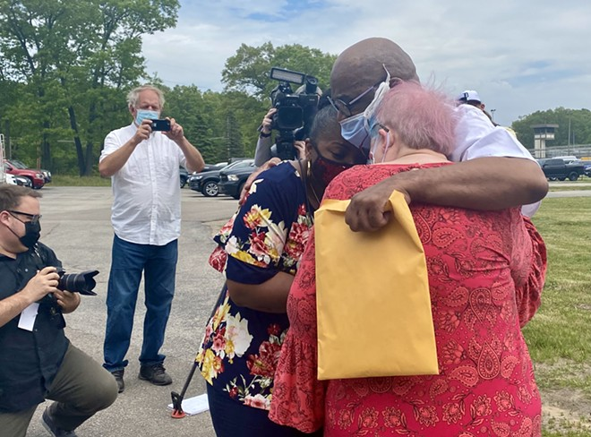 Ray Gray is greeted by his sister Phyllis Long and his wife, Barbara Rinehart-Gray, outside the walls of the Muskegon Correctional Facility, Tuesday May 25, 2021. - DAVE MESREY
