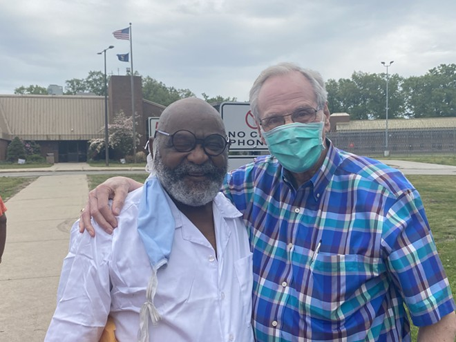 Ray Gray celebrates his freedom in Muskegon Tuesday with Humanity for Prisoners founder Doug Tjapkes. - DAVE MESREY