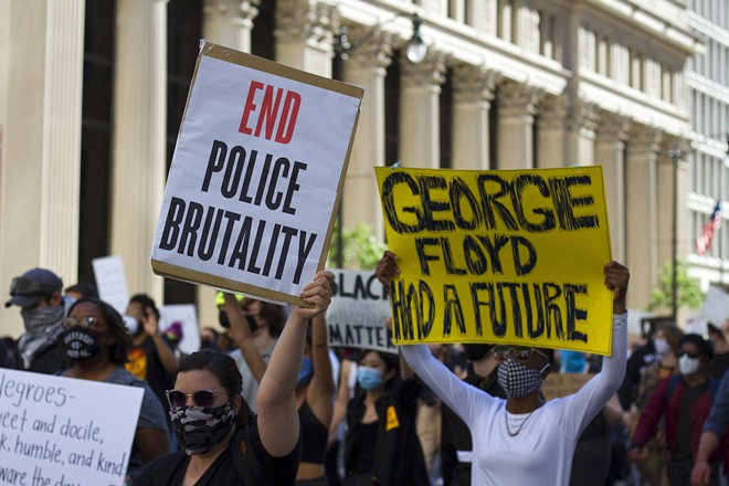 Protesters march in Detroit following the death of George Floyd last year. - STEVE NEAVLING