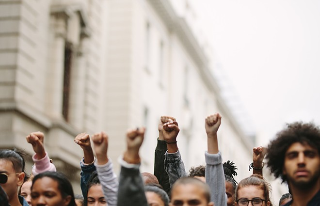 Critical race theory is less about blaming white people than interrogating systems of power . That's the very thing that frightens conservatives. - SHUTTERSTOCK