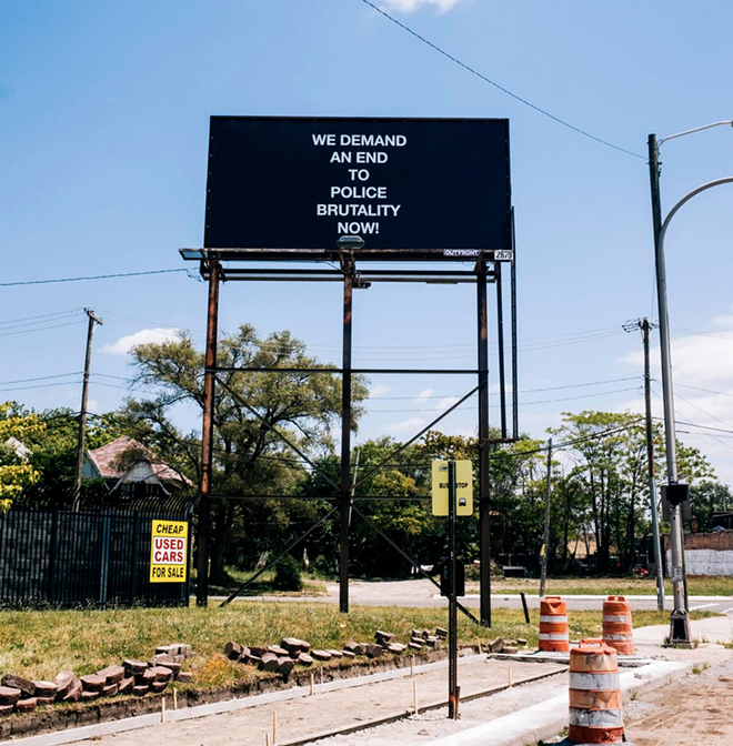 """""""WE DEMAND AN END TO POLICE BRUTALITY NOW!"""", 2019 // 22"""" X 11"""" feet, Billboard, W Warren Ave & Wesson St, Detroit, Michigan. - ART BY ADESHOLA MAKINDE, COURTESY OF PLAYGROUND DETROIT"""