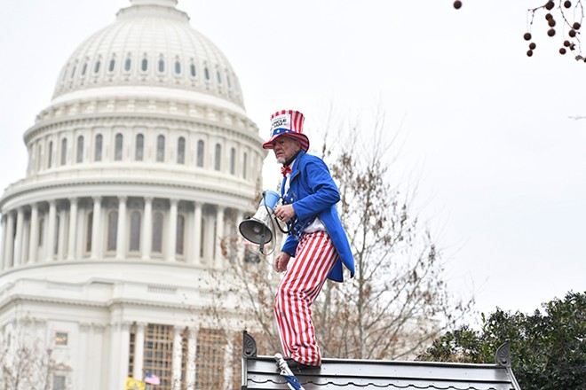 A rioter at the Jan. 6 insurrection dressed as Uncle Sam. - GALLAGHER PHOTOGRAPHY / SHUTTERSTOCK.COM