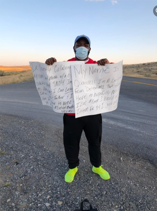Wright held up signs outset Kanye West's Wyoming home to try to catch his attention. - COURTESY PHOTO