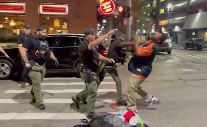 Screenshot of video showing a Detroit cop punching a man in the face in Greektown. - SCREENSHOT