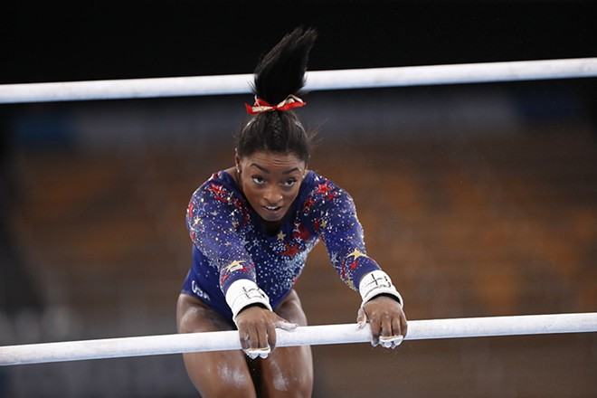 Simone Biles joins a rare list of GOATs, including Muhammad Ali, Jackie Robinson, Colin Kaepernick, and Billie Jean King, whose courage in and out of the arena taught us something more about ourselves. - A.RICARDO / SHUTTERSTOCK.COM