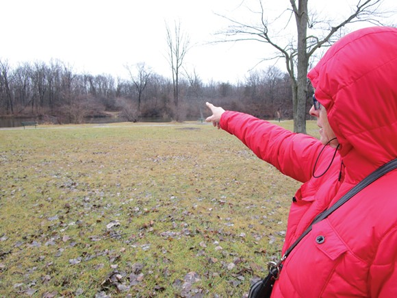 Kathy Schoen points to a bend in the river that would permanently lose more than two acres of trees if the pipeline gets built. - PHOTO BY MICHAEL JACKMAN