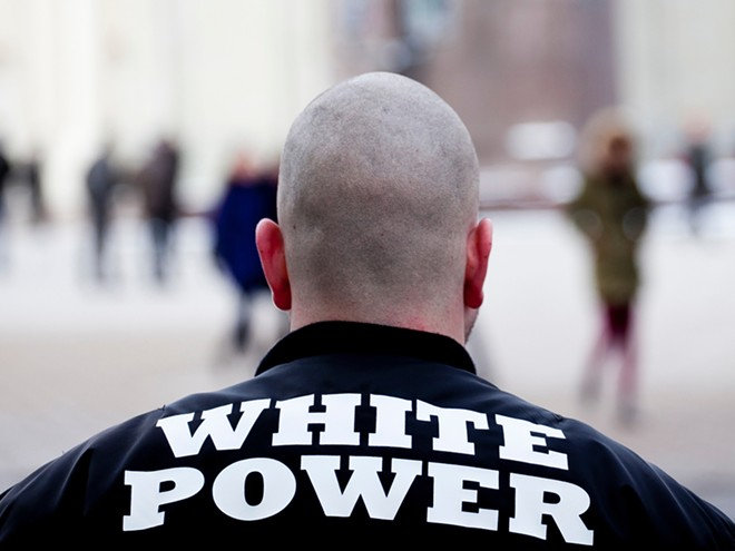 Three members of The Base, a neo-Nazi movement, who have been charged. - SHUTTERSTOCK.COM