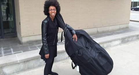 Robotics expert and upright bass player Zwena Gray will be just part of the all-female musical entertainment. - PHOTO COURTESY IWDC