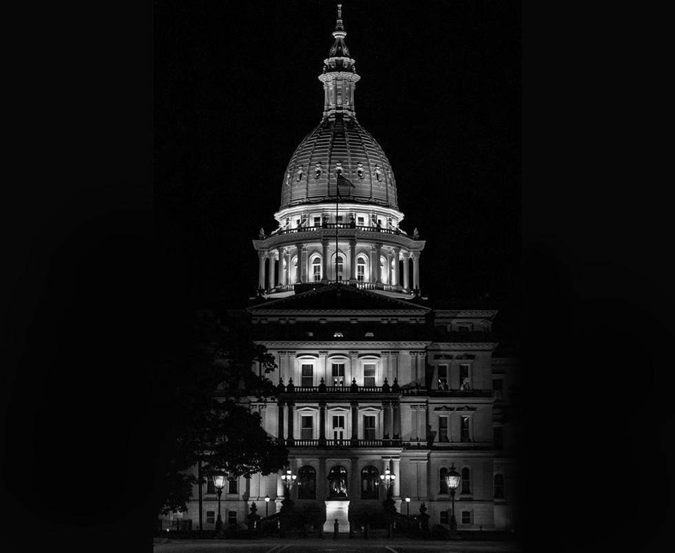Lansing State Capitol Building in Michigan under the cover of darkness. - MCKEEDIGITAL, SHUTTERSTOCK