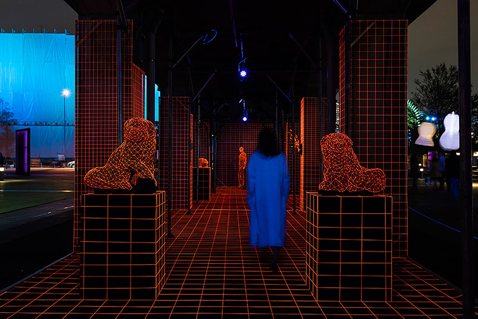 Artist Takayuki Mori covers objects in fluorescent lines, creating the illusion of a 3D virtual reality world, as part of Detroit's Electricity festival. - KEN KATO