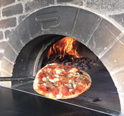 A Wood Fired Up pizza. - WOOD FIRED UP FACEBOOK PAGE.