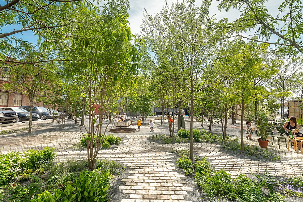 A former parking lot is now Core City Park, an inviting courtyard plaza surrounded by new businesses. - CHRIS MIELE