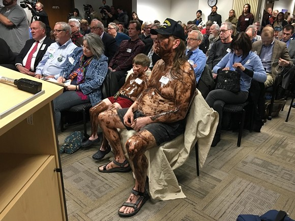 A man and his grandson covered themselves in syrup to protest Enbridge's controversial Line 5 Great Lakes pipeline. - VIA REDDIT USER PISCESMAN