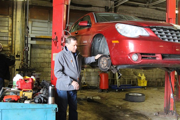 Tony Greiner in his Metro 25 auto shop on Detroit's east side. - SARAH RAHAL
