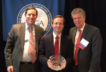Lt. Gov. Brian Calley poses with public health award from the National Lieutenant Governors Association. - NATIONAL LIEUTENANT GOVERNORS ASSOCIATION
