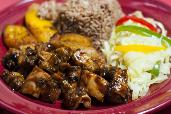 Jerk chicken at Jamaican Pot. - PHOTO BY TOM PERKINS