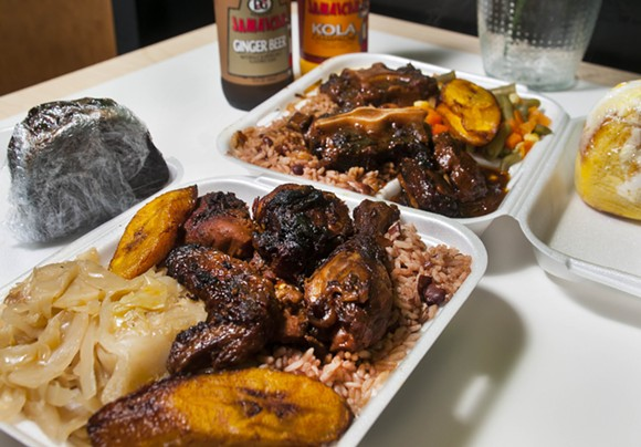 Jerk chicken and Jamaican Oxtail at Caribbean Citchen. - PHOTO BY TOM PERKINS