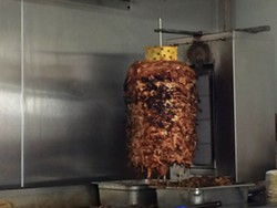 Meat for the tacos al pastor is cooked on a trompo, which is a Mexican spit. - PHOTO BY TOM PERKINS