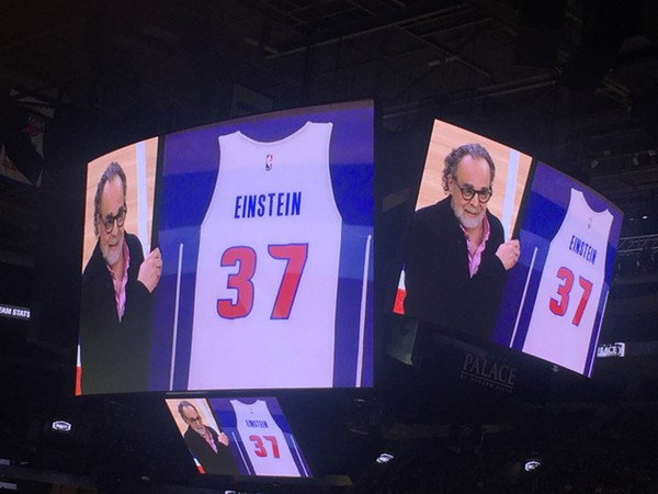 Pistons photographer Allen Einstein is honored at the Palace of Auburn Hills on April 5 with a jersey commemorating his 37 years with the team.