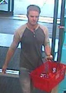 Kyle Bessemmer entering a store to spray rat poison. - FBI