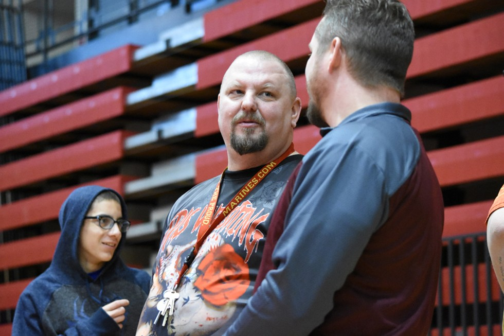 Brent Harvey (left) is one of the main promoters of female wrestling in Michigan. - RACHEL TIMLIN