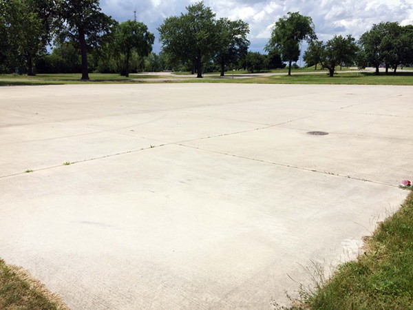 In previous years, Grand Prix organizer Roger Penske's team laid concrete in spots that its vehicles tore up, thus turning parts of the park into parking lots. - PHOTO BY TOM PERKINS