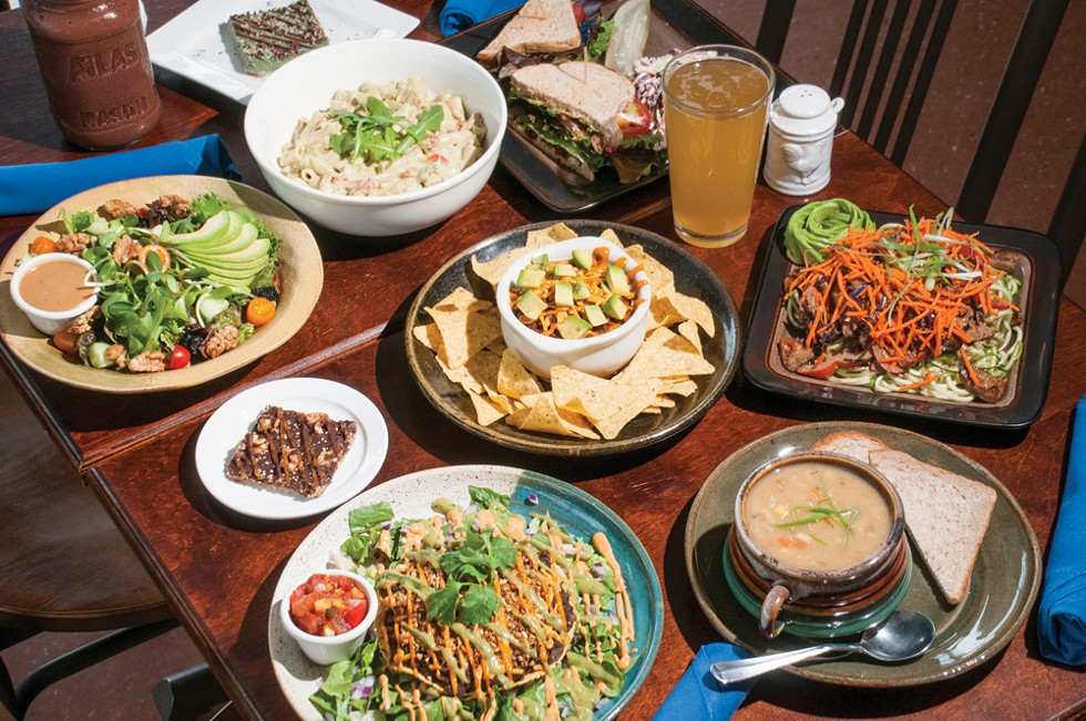 (Counterclockwise from bottom left) Tostada, magic bar, Michigan Salad, Arugala Alfredo, ABLT, s mug of Neu Kombucha, Thai pasta salad, lima bean corn chowder, Southwest Appetizer w/sloppy joe (center). - TOM PERKINS