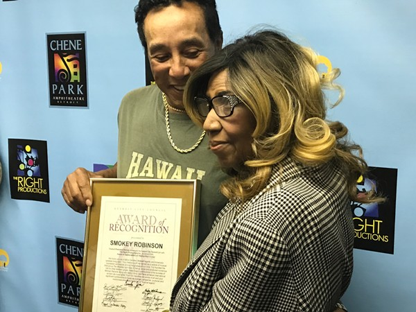 Aretha Franklin presents a City of Detroit Award of Recognition to Smokey Robinson before his performance at Chene Park Amphitheater. - DAVID E. RUDOLPH