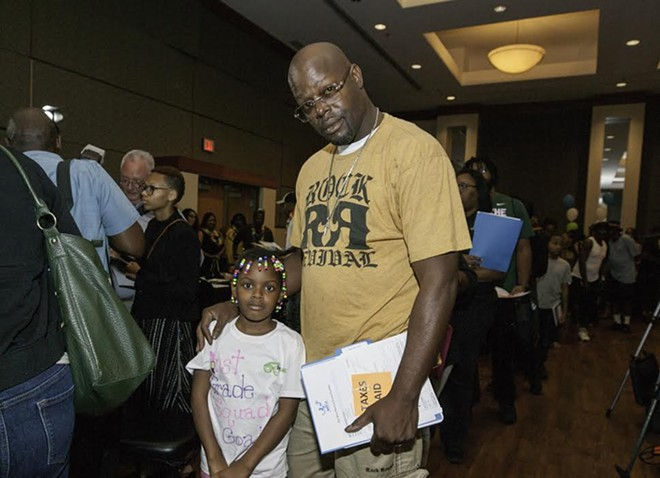 A participant of Detroit's new occupied buy-back program for foreclosed homes owned by the Detroit Land Bank Authority. - K.SHABU CCSD/CITY OF DETROIT