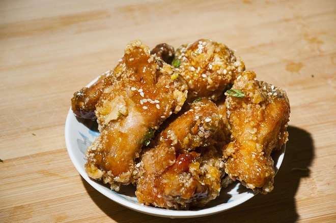 Spicy orange wings from Common Pub. - TOM PERKINS