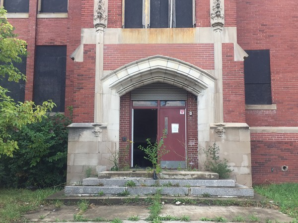 A front door removed at the vacant Sampson Elementary on Detroit's west side. Detroit officials spent nearly $1 million boarding it and other schools in 2015. - VIOLET IKONOMOVA