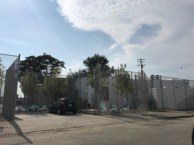The security granted by these 16-foot-high fences? Purely secondary. - MT PHOTO