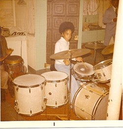 A young Gayelynn McKinney plays the drums. - COURTESY PHOTO