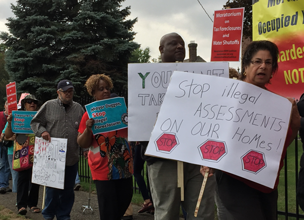 "Protesters call on the Wayne County Treasurer to halt the auction until the problem of ""illegal tax assessments"" can be resolved. - VIOLET IKONOMOVA"