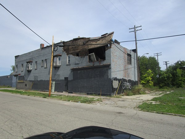 Dilapidated building on Bellevue Street south of Mack Avenue. - MICHAEL JACKMAN