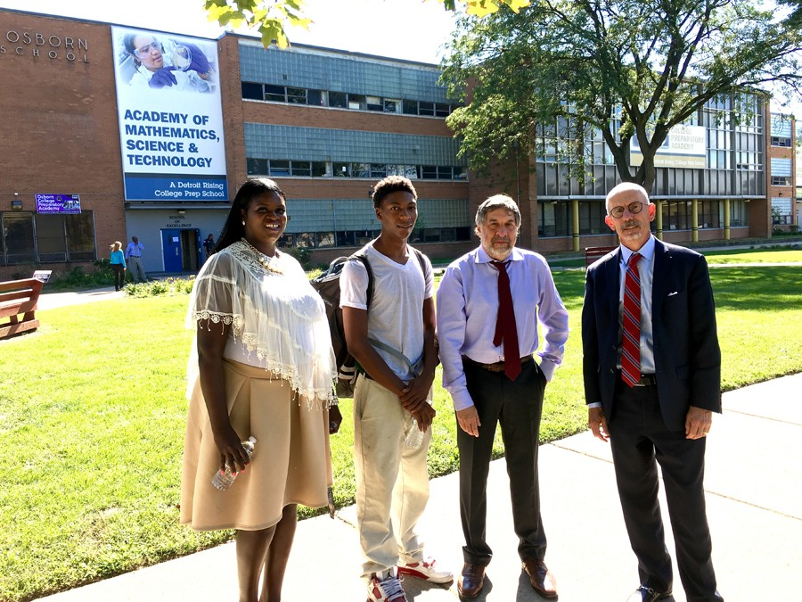 Left to right: Osborn college adviser Andrea Jackson, Jamarria Hall, Public Counsel's Mark Rosenbaum, and co-counsel Mike Kelley in front of Osborn High School. - PHOTO COURTESY ANNE HUDSON-PRICE