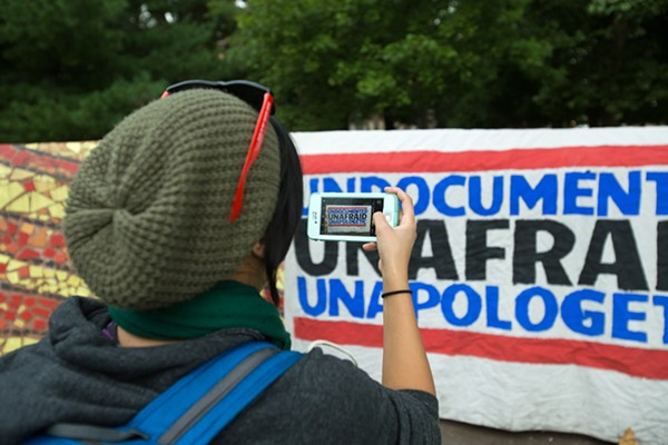 """People protest President Donald Trump's announcement to end the Deferred Action for Childhood Arrivals program at a """"Defend DACA"""" rally in Clark Park in Southwest Detroit on Tuesday, Sept. 5. - NICK HAYES"""