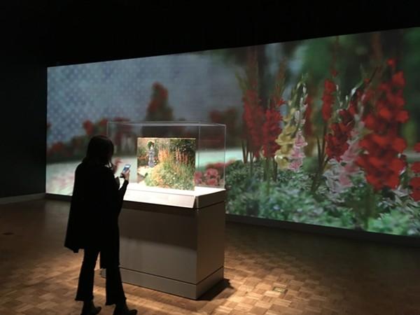 "Monet's ""Rounded Flower Bed (Corbeille de fleurs),"" presented in an immersive garden. - LEE DEVITO"