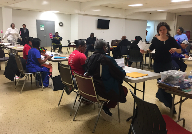 Volunteers help Detroit residents facing tax foreclosure apply for assistance to stay in their homes. - COURTESY PHOTO