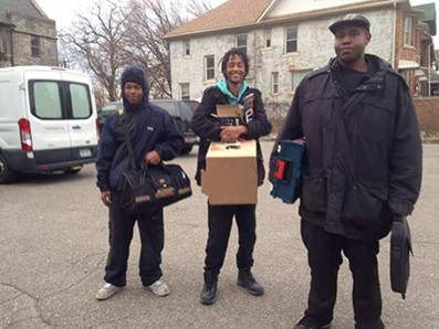 The Equitable Internet Initiative, including digital steward Dwight Roston, middle, aims to install internet for 50 homes in three different Detroit neighborhoods. - COURTESY PHOTO